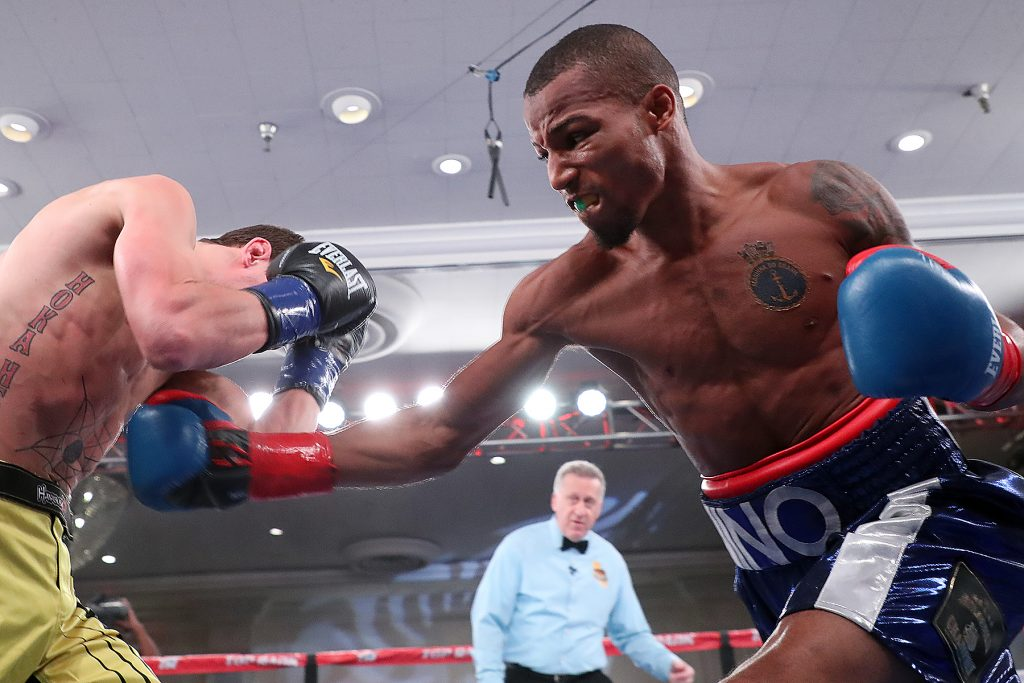 January 27, 2017- Studio City, Ca. USA Robson Conceicao (R) connects a right on Aaron Ely (R) at the Sportsmen's Lodge Event Center.   Photo Mikey Williams / Top Rank